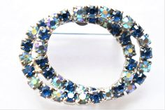 "Vintage Blue Rhinestone Geometric Interlocking Circle Brooch Silver Tone Coat Sweater Pin Retro Costume Jewelry 1.25"" by DecoOwl5 on Etsy"