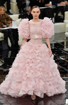 Stunningly cute ... Lily-Rose Depp looked like a cute pink cream puff in a frilly wedding style dress. Picture: pascal Le Segretain/Getty Images