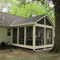 Low-level, gable roofed screened in porch. Added out-swinging french doors for easy access.