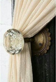Old door knob as curtain pull back just beautiful.