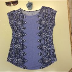 Lilac Summer Top This shirt is a beautiful fitted  lilac top with it's pretty design. It can be dressed up or down. Looks great with everything. 97% rayon, 3% spandex, so it keeps its shape beautifully! CB Tops Tank Tops