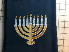 Chanukah towel. Embroidered on blue cotton kitchen towel. $13