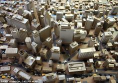 Cardboard city by Kiel Johnson. Kiel is a friend of mine from days of yore, and his sculptures blow me away.