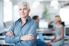 Stock-Foto : Portrait of a confident man with his arms crossed