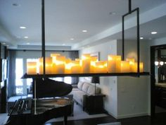 """Metal Candle Chandelier could easily be DIY project.  Tip - if you're worried about candles you can replace them with new """"electric candles."""""""