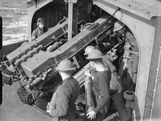 """Crew of a 4.7 inch High Angle gun """"closed up"""" ready to face an aerial attack on board HMS JAVELIN whilst she was at sea. Note the men standing by with further ammunition to be fired."""