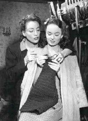 Joan Crawford again, this time with Ann Blythe on the set of Mildred Pierce