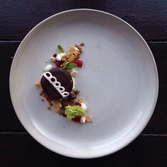 """Pin for Later: You Won't Believe What This Gourmet-Looking Food Really Is  Hostess cupcake with rainbow Dunkaroos, yogurt raisins, """"some Nibz and Starbucks mocha frap caviar."""" Plus a """"tiny mint and piece of fancy moss!"""""""