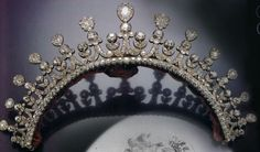 """Kleines Diadem"" a diamond tiara of the Thurn & Taxis family, early 1800s. Designed as a crescent of paired volutes and foliage, capped with detachable pear-shaped cluster drops, set throughout with cushion-shaped diamonds. Provenance: Therese, Duchess of Mecklenburg-Strelitz. She married Erbprinz Carl Alexander von Thurn und Taxis, who succeeded his father as Fürst in 1805."