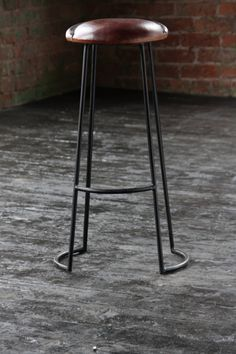 An industrial chic aged antique leather bar stool with metal frame. Our industrial chic bar stool would look great in a trendy urban style kitchen