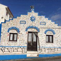 Cute house with broken tiles mosaic wall #tileaddiction #portugal #ericeira by jaczc