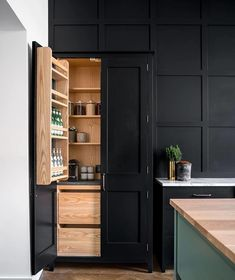 Dress up your kitchen cabinetry by painting it in deep, rich hues like #OffBlack that create a beautiful contrast with internal shelving.…