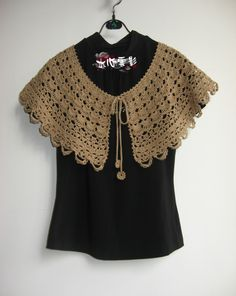 Short crochet poncho or ponchette...I love this but it is in Chinese.  Does have a chart if you can read it.