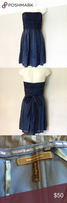 BCBG Margo Silk Blue Strapless Dress BCBGMAXAZRIA Margo dark blue silk party dress. This 100% silk shelled beautiful dress is strapless with an empire waist and long sash ties in the back. Dress is in excellent condition!! BCBGMaxAzria Dresses