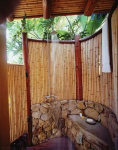 Outdoor shower idea-- too large, but like the bamboo as an inexpensive or even free material for privacy. I think I would like it roof-less, also.