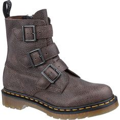 Our famous boots and shoes have become icons, recognized worldwide for their uncompromising looks, durability and comfort. The Blake style is an adaptation of our core 8-eye boot, with the lacing replaced by three functional buckle straps.This boot features the original Dr. Martens air-cushioned sol