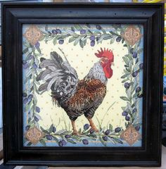 Cross stitch of a Rooster.  Framed here with no mats, offset from the UV Conservation Control glass.  Framed by Frameworks of Utah. #crossstitch #customframing #frameworksofutah #pictureframing
