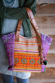 Vibrant Stitches Bag made from vintage H'mong fabric and vegan leather in Vietnam. | Noonday Collection