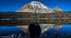 Dave and Jamie from Photo Jeepers at Mirror Lake with a mountain reflection in the water