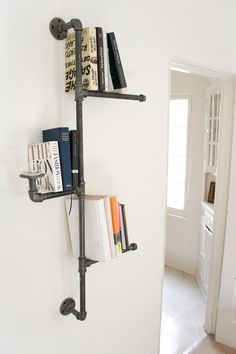 What an awesomely fun bookshelf. Industrial Pipe Bookshelf without Oil Candle. $119.00, via Etsy.
