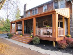 diy - this is a really nice back patio. I would prefer to be a stair-less patio. I think I would prefer for the wood railing to be stone. Overall design is nice.