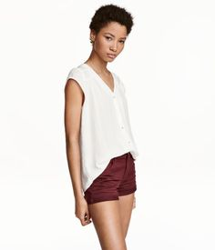 White. CONSCIOUS. Short-sleeved blouse in airy woven fabric with buttons at front. V-neck, gathered yoke at back, and pin-tucks with gathers at shoulders.