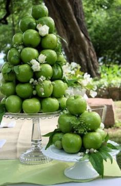 fruit and veggie centerpieces? green apple, red tomato, lemon, orange... might be hard to get to 15 tables...
