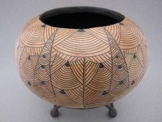 brown and black patterned gourd by Audrey Fontaine