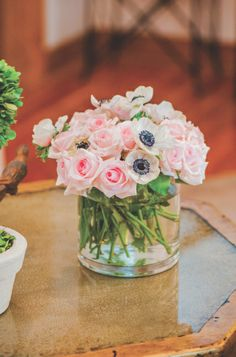 Perfectly Pink Baby Shower: Centerpiece of light pink roses with white anemones   Photo by adam + alli photography for Mississippi Magazine