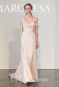 Brides.com: . One-shoulder blush silk chiffon A-line wedding dress with a floral lace embellished corset, Marchesa