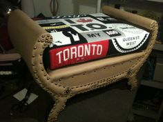 My entry for the 2012 Chair Affair. Vintage bench reupholstered in tan leather with reversible cushion made from various secondhand Toronto-themed t-shirts. Vintage Bench, Tan Leather, Affair, Toronto, Ottoman, Upholstery, Cushions, Shirts, Furniture