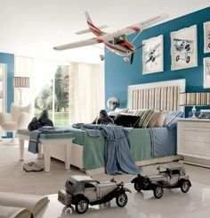 boy airplane room, I like the photos of the planes and the colors. I love the plane hanging from the ceiling! Dexters new room.