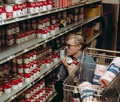 Andy Warhol buying Campbell's Soup at Gristede's supermarket on Second Ave, 1964. Photograph by Bob Adelman.