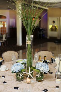 Whimsical Starfish Accented Centerpieces With Greenery