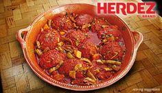 Tortas de Camaron - Spicy crisp shrimp fritters in salsa ranchera and nopalitos