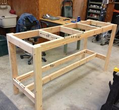 DIY Workbench. I like the bottom shelf only being half-depth, so you can stand close to the worktop.