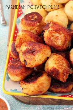 Parmesan Potato Puffs   Crispy outsides give way to creamy puffy middles that melt in your mouth! Plus my secret fry dipping sauce. cinnamonspiceandeverythingnice.com