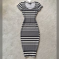 BLACK AND WHITE MIDI DRESS New with tag midi dress! Very very beautiful on body, Takes you body shape perfectly and comes Pencil style! Material is very stretchy! Size S but can Be good for M size to! you will LOVE itNot Zara brand Zara Dresses Midi