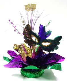 DIY Masquerade Centerpiece Kit. Who needs a decorator? It's easy to make your own Mardi Gras table decorations!