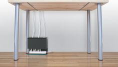Plug Hub - an under-desk cord management station that hides your power srip and cords.  (Can also be mounted under the desk/table.)