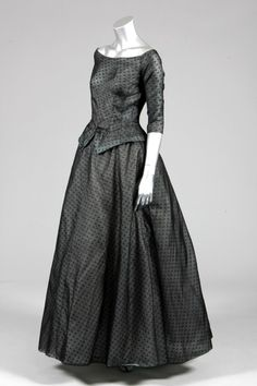 Christian Dior couture spotted black ball gown, A-line collection, Spring-Summer, 1955, the bodice cut low across the shoulders, light boning,with lining and underskirt of pale blue organza, above two tulle and ivory silk integral petticoats