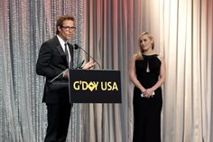 Guy Pearce accepting award from Mildred Pierce co-star Kate Winslet at 2012 LA Black Tie Gala