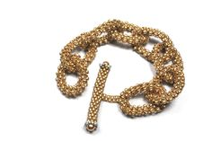 Brushed Gold Beaded Chain Link Bracelet Chunky chain link bracelet made with Toho bronze lined crystal matte gold seed beads. Swarovski pearl accented beaded toggle clasp adds a focal point to this simple but elegant design. Can be made any size to fit or hang the way it feels most comfortable. Weighs only 1.1 ounces! Handmade Beaded Jewelry, Handmade Bracelets, Link Bracelets, Beaded Bracelets, Swarovski Pearls, Bracelet Making, Jewelry Making, Matte Gold, Gold Beads