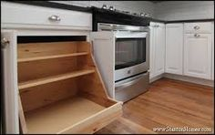 A pot and pan organizer is designed to hold large pots on the bottom shelf, and lids on the upper shelves. Home Kitchens, Custom Kitchens Design, Kitchen Design, Home Building Tips, Bungalow Kitchen, Kitchen Cabinet Styles, New Homes, Kitchen Cabinetry, Kitchen