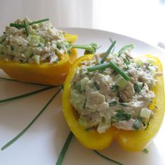 Chicken salad-stuffed peppers only 92 calories  12 oz cooked boneless, skinless chicken breast, cubed  ¼ cup scallions  ¼ cup diced celery  ½ cup Smart Beat® Mayonnaise (or your favorite light mayo)  1 tbsp fresh chives, chopped  ⅛ tsp salt  ⅛ tsp black pepper  3 large bell peppers, any color, cut in half lengthwise with seeds and membranes removed  cayenne pepper (to taste)