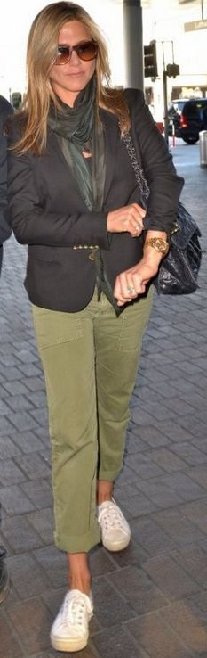 Who made  Jennifer Aniston's black handbag, gold watch, green pants, and white sneakers that she wore at LAX airport?