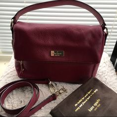 "NWT Kate Spade Handbag NWT Kate Spade Mini Maria handbag in bucchusred(like a maroon tone).  Has just been sitting in my closet so gnna let someone else enjoy this beauty.  Has a foldover flap w zip compartment and magnetic closure.  Interior has signature fabric lining w 1 zip and 2 side pockets.  Measurements: 9""L/7""H/4""D.   Single handle 3.7"" drop/longer strap 20""drop.  Great bag for dressy and casual occasions kate spade Bags Crossbody Bags"
