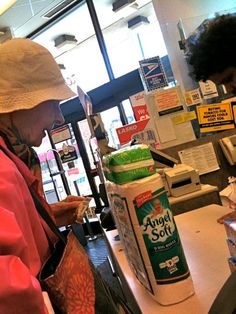 Old lady buying TP and panty shields