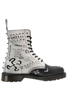 Dr. Martens's signature army boot was invented in the 1940s in Monaco by an injured German doctor. When he sold the style to an English shoemaker, the army boot became a symbol of the most influential youth movements in history: from punks to goths and from pop to the beat generation. - CORE STUDDED GRAFFITI LEATHER BOOTS - LUISAVIAROMA - LUXURY SHOPPING WORLDWIDE SHIPPING - FLORENCE