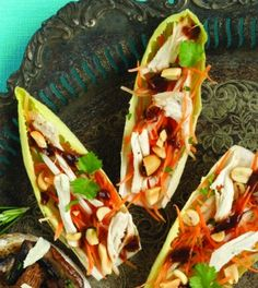 Thai Chicken Endive Boats: Impress your guests with these mouthwatering endive boats - with only 35 minutes of work! Bean sprouts, carrots and cilantro are tossed with seasoning then topped with chicken breast and creamy peanut sauce to make the ultimate exotic appetizer.